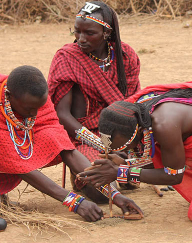 Maasai Warriors Building Fire in Tanzania